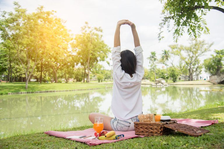 Woman stretching at a picnic